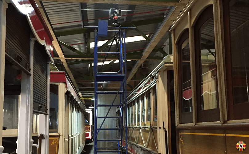 3D Engineers scanning Isle of Man Manx railways tram roofs in railway workshop. Cherry picker used.