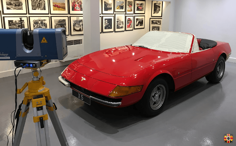Red Ferrari Daytona Spider with top down being 3D laser scanned by 3D Engineers as part of car recording project.