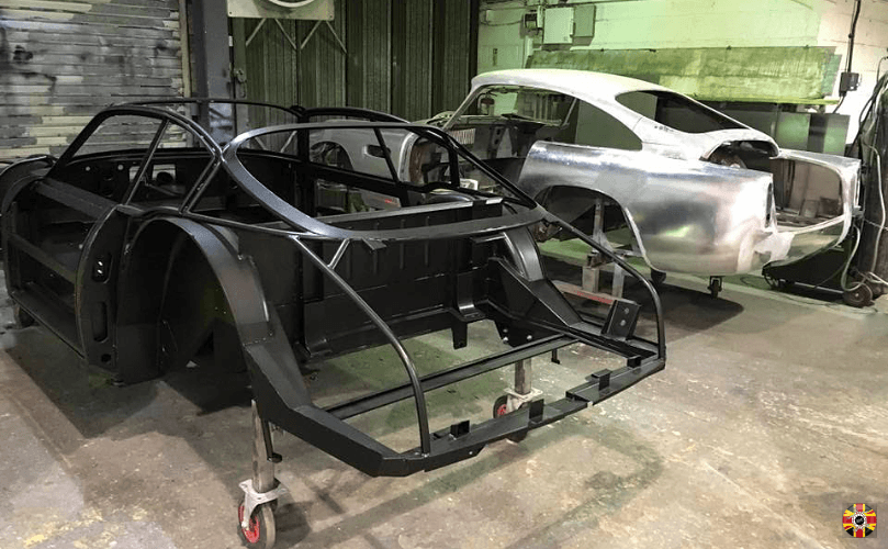Aston Martin DB4 GT alongside Zagato chassis that is about to be laser scanned by 3D Engineers.