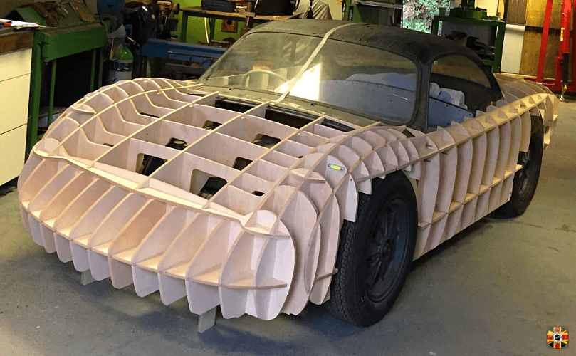 Okrasa Special car section egg crate body buck designed by 3D Engineers fitted around and on chassis.
