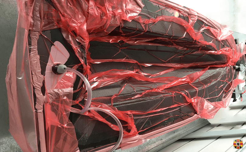 3D Engineers use resin infusion process to create carbon fibre model boat hull.