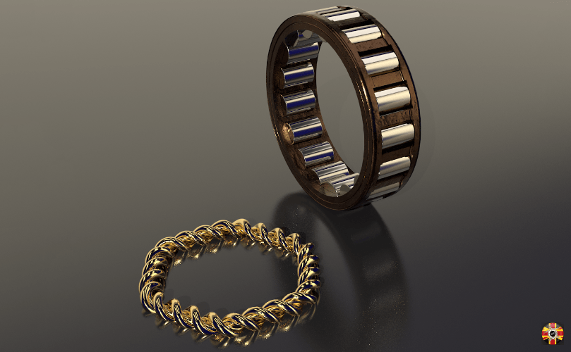Jewellery designed by 3D Engineers. Shown is a Bugatti roller bearing ring and an entwined family bonding ring.