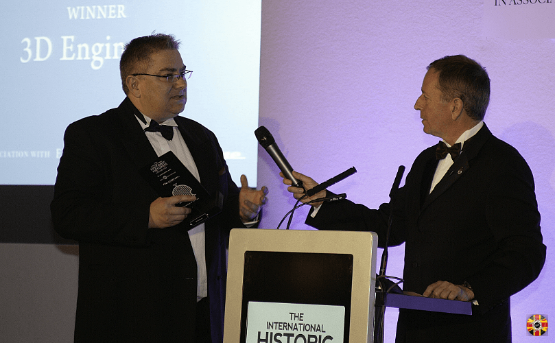 Stuart Brown, 3D Engineers, wins International Historic Motoring Awards innovation of the year. Martin Brundle hands over.